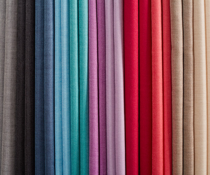 Close up of colorful folded Tuwi scarves selection